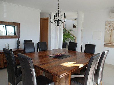 Spacious dining room with access to semi covered terrace, BBQ area and pool